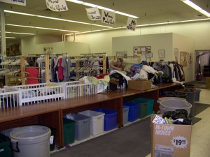 Drop-side cribs find a second life as sorting bins at NAM thrift store