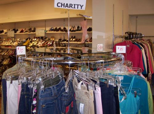 This charity rack in a consignment shop is divided into easily-shopped segments, by price.