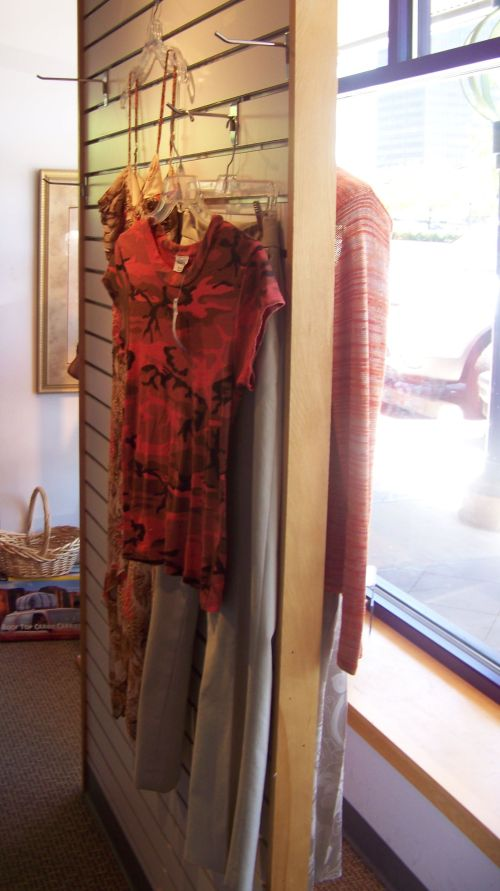 Double-sided window display in a nonprofit consignment thrift store St. Louis