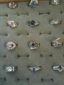 Regimented costume jewelry rings
