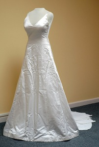 Wrinkled wedding gown in a resale shop