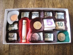 Candy box currency makes the cah gift even sweeter says HowToConsign.com