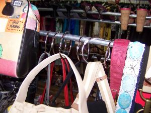 Designer purses secured against theft in a consignment shop