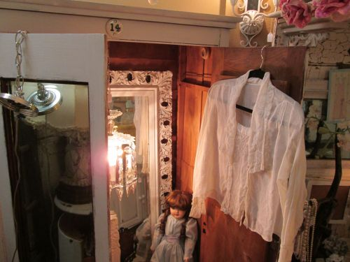Another ajar armoire (say that 3 times fast!), this time with a small table lamp, a mirror, and more. Makes each piece look SO much more interesting and desirable. Now that's using all your space!