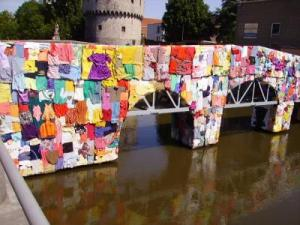 Not all discarded clothing is lucky enough to adorn a bridge.