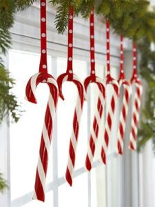 Giant candy cane yard ornaments WOW in our consignment shop window