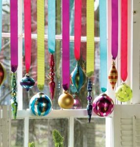 Ornaments hung on ribbons trim your resale shop window quickly, and take up no room!