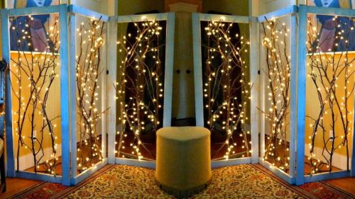 Make a window backdrop with twinkle lights in your consignment shop