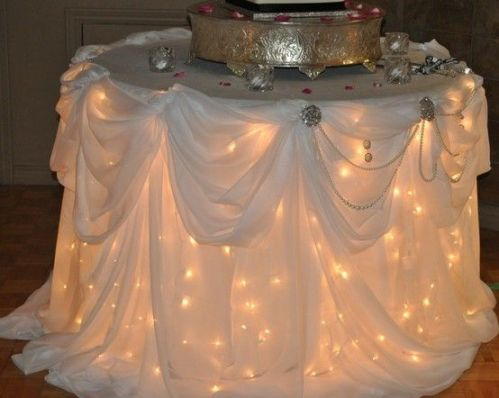 Twinkle lights under the swing-shop skirted table