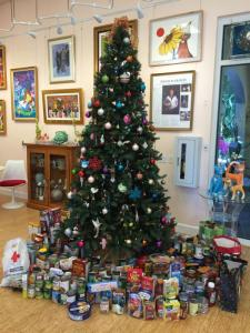 The tree with food donations under it!